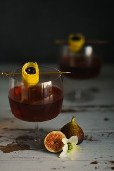 portrait of a cocktail fig manhattan // 2 oz. fig-infused rye + dry vermouth + sweet vermouth + bitters + lemon peel & luxardo maraschino cherry