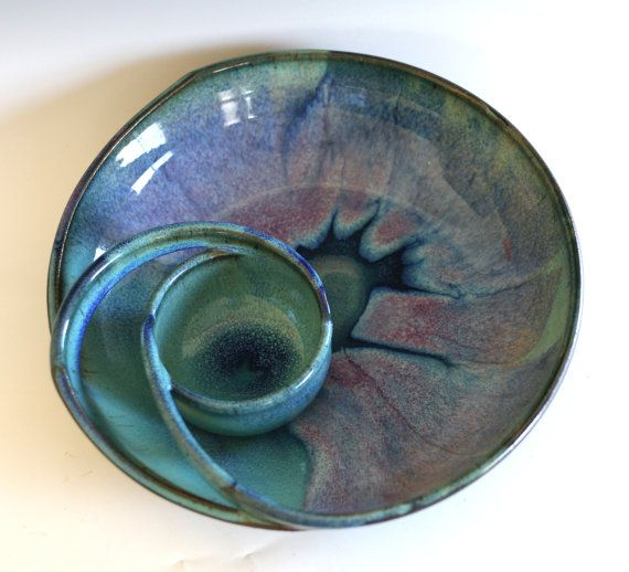 11.5 wide. 2.75 tall This wheel-thrown and handcrafted serving plate with attached dip bowl is