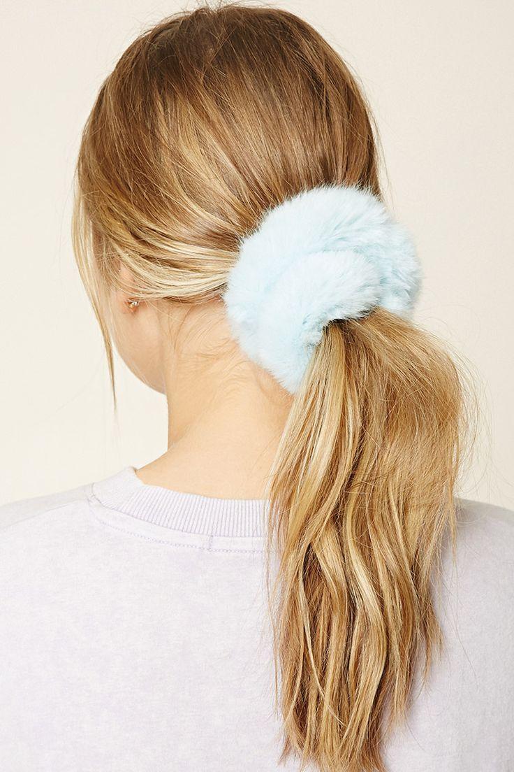 A hair scrunchie featuring faux fur and an elastic band.