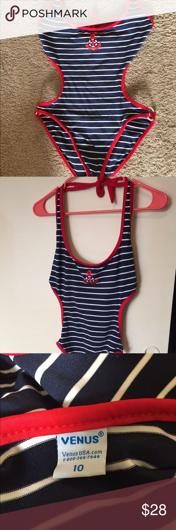 Nautical Striped Monokini One Piece Swim Size 10 This one piece Monokini swimsuit/bathing suit is a nautical navy and white stripe with red accents and an embroidered anchor. Size 10. Ties in the back and around the neck. Has white circular metal prices on either side of the waist. Venus Swim One Pieces