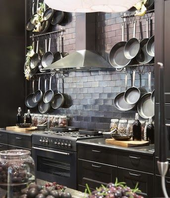 Ikea's Glamorous Black Country Kitchen.......Love the black but maybe a little less pans!