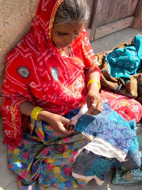 Woman stitching Rajasthani patchwork design. Sadhna. Udaipur.