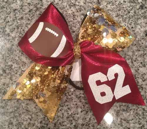 Bows by April - The Football Fan Bow with Football Graphic Customized with a Name or Number, $16.00 (http://www.bowsbyapril.com/the-football-fan-bow-with-football-graphic-customized-with-a-name-or-number/)