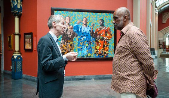 """Take a With Art Philadelphia video tour with Danny Simmons. At the Pennsylvania Academy of the Fine Arts he gets close with """"Three Wise Men Greeting Entry Into Lagos"""" by Kehinde Wiley, talks about mural making with  with Jane Golden, tours the Barnes Foundation and the Brandywine Workshop. (Photo Credit: L. Whitaker for GPTMC)"""