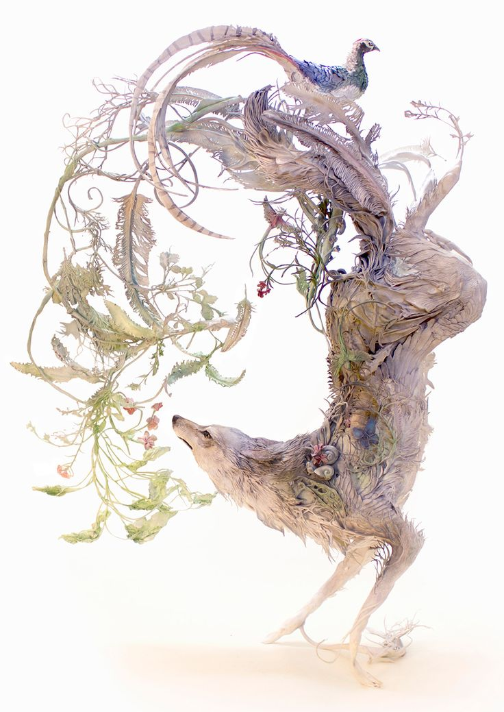 Ellen Jewett (previously) effortlessly blends animals with elements from their environments, creating ceramic pieces that often balance unexpected species together in a singular piece. Each work is highly detailed—flowers, leaves, and vines wrapping themselves around animals from coyotes to chameleons.