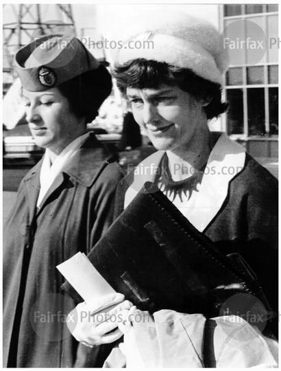 Mrs Bogle and her three children board a plane at Mascot airport, Sydney, 19 June 1965. Mrs Bogle is taking her family to New Zealand following the unsolved death of her husband, Dr Bogle.  SMH Picture by Adams