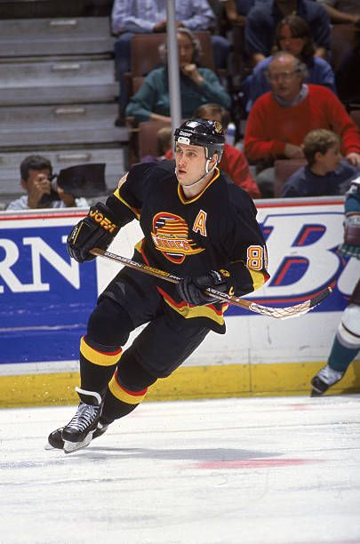 Russian hockey player Alexander Mogilny of the Vancouver Canucks skates on the ice during a game against the Anaheim Mighty Ducks Anaheim California...