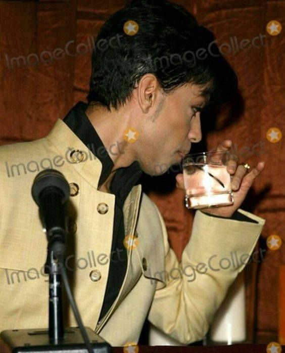 Very rare pic of Prince sipping water.