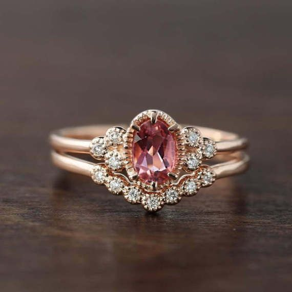 14k rose gold ring featuring ethically sourced 6x4mm pink tourmaline. Pink tourmaline is the birthstone of the month of October, will make an unique engagement ring for women who wants something bit different from ordinary diamond engagement ring. This antique inspired ring has leaf gallery design on setting allowing more lights to go through the stone to maximize the brilliance of the stone. The band is tapered to give delicate look yet being sturdy. Made with 100% recycled 14k rose gold…