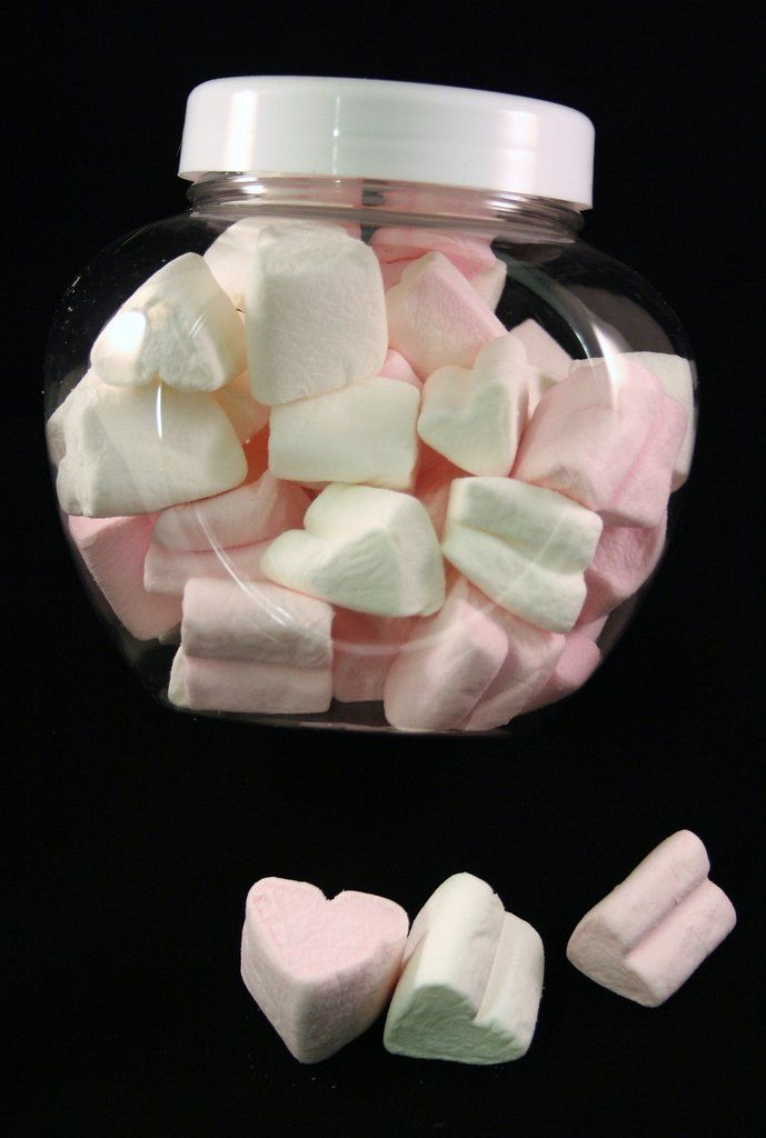 marshmallows pink and white heart shapes in heart shaped jar
