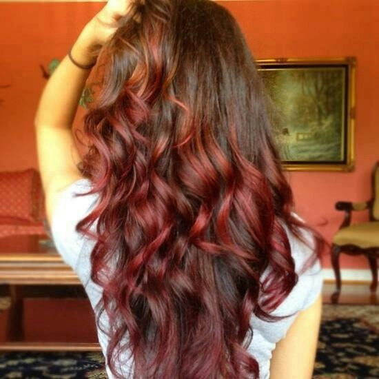Go bold and try this ombre brunette to red look with long layers and curls for days!