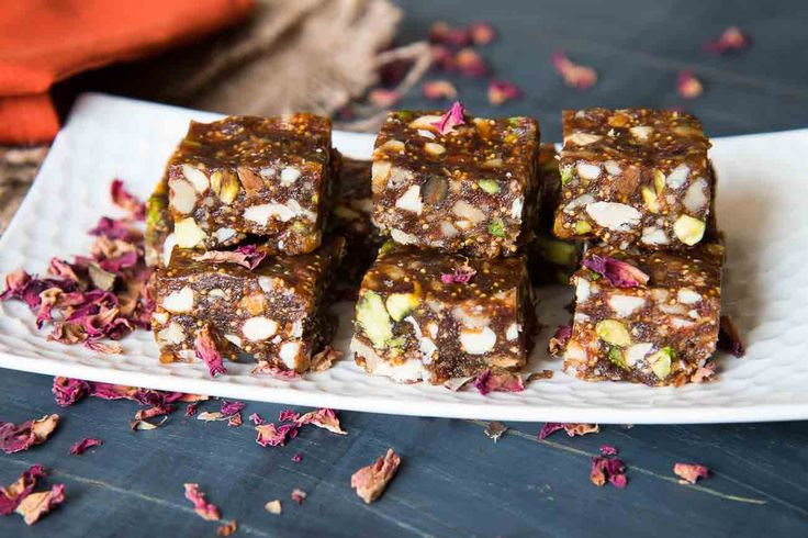 The Dry Fruit Burfi Recipe is a super healthy and delicious sweet that you must make either for a quick energy booster or for festivals. This recipe has a slight twist to it with the addition of Gulkand. GUlkand is a flavored jam made from rose petals and when added to sweets like this Dry fruit Burfi, brings out great flavors and taste.