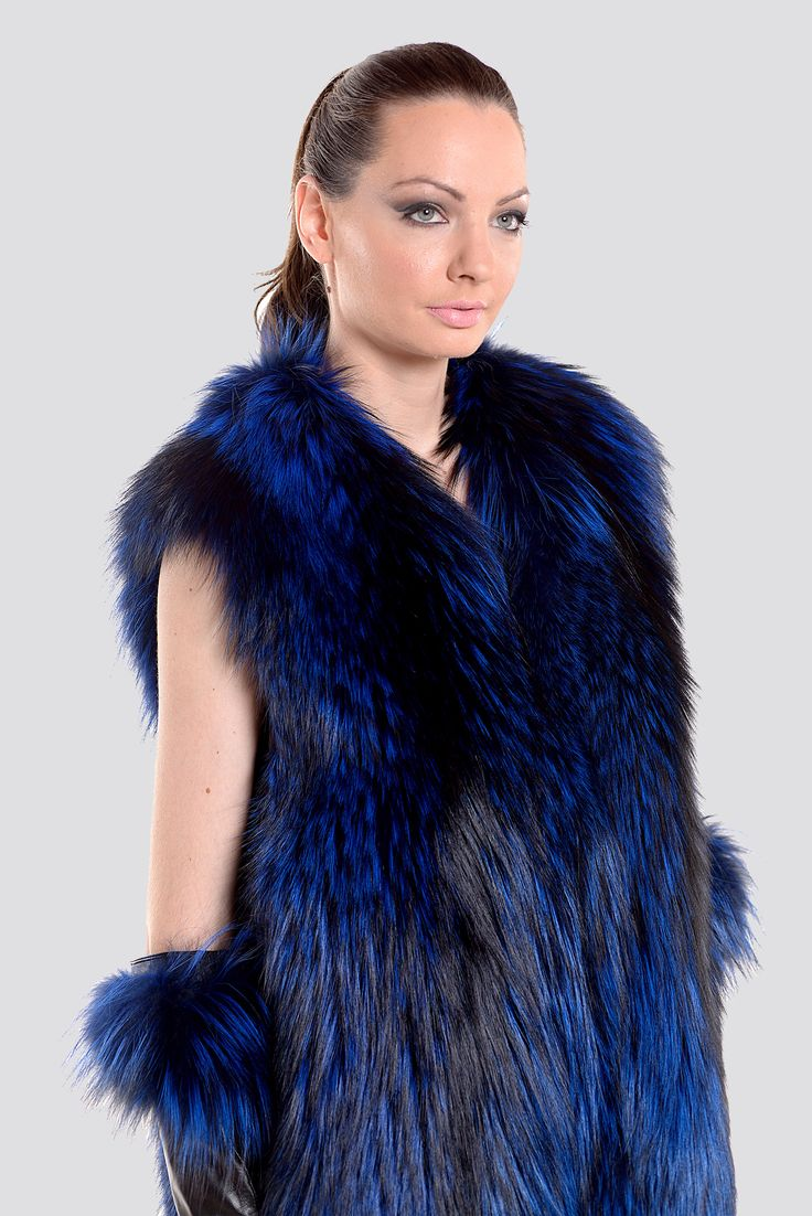 Live authentic wearing this stunning blue fox fur long vest.