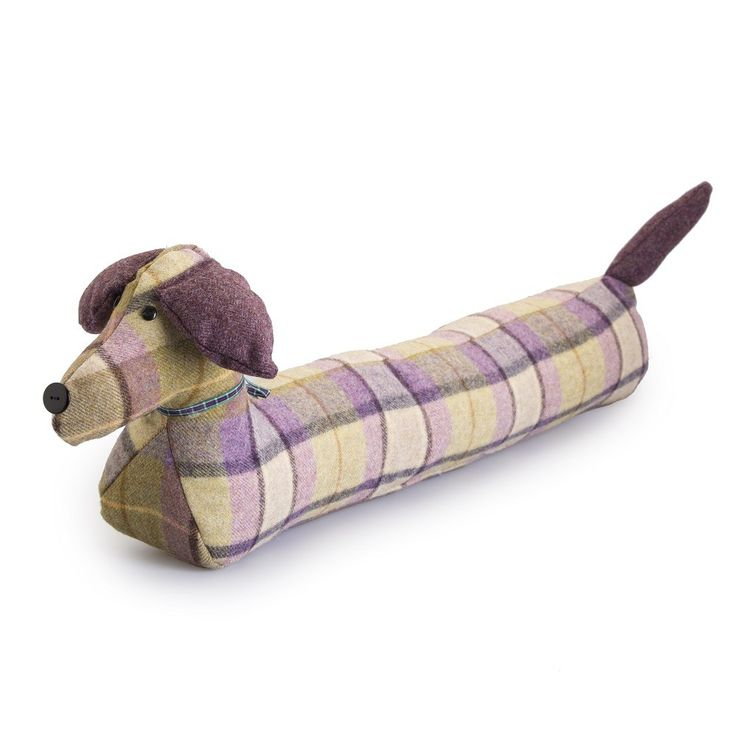 This mauve and green check draught excluder is handmade with 100% wool outer with polyester filling. A charming character in the shape of a Sausage dog. Created by a talented British upholstery manufacturer. Size: 200 x 25 x 20cm. Dry clean only.