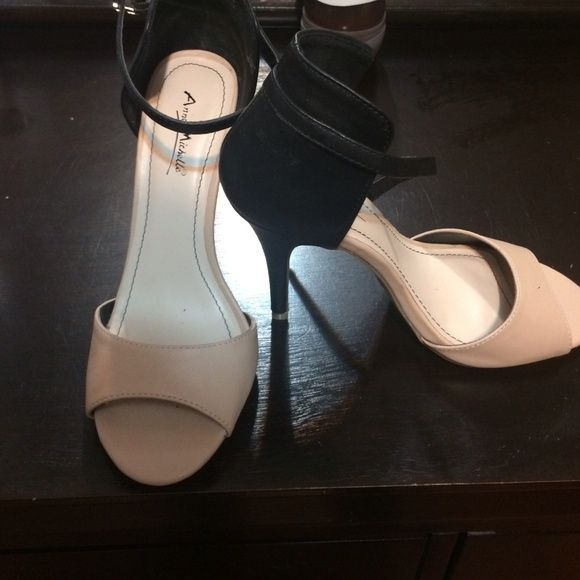Black and Cream high heel sandals Black & Cream high heel sandals. Never worn. Comfy shoes! Anne Miller Shoes Sandals