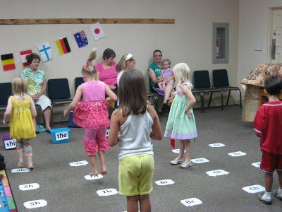 tavuhyppyrata & hernepussit Laminate and tape several consonant blends to the floor. The ones featured in the book are Sh, Br, Th, Ch, Gr. Create aword basket at the end that uses the same blend. Start each child with a beanbag or  pair of rolled up socks. With feet together, they jump on each blend and say the sound as they land. Then they throw the beanbag into the basket and read the word.
