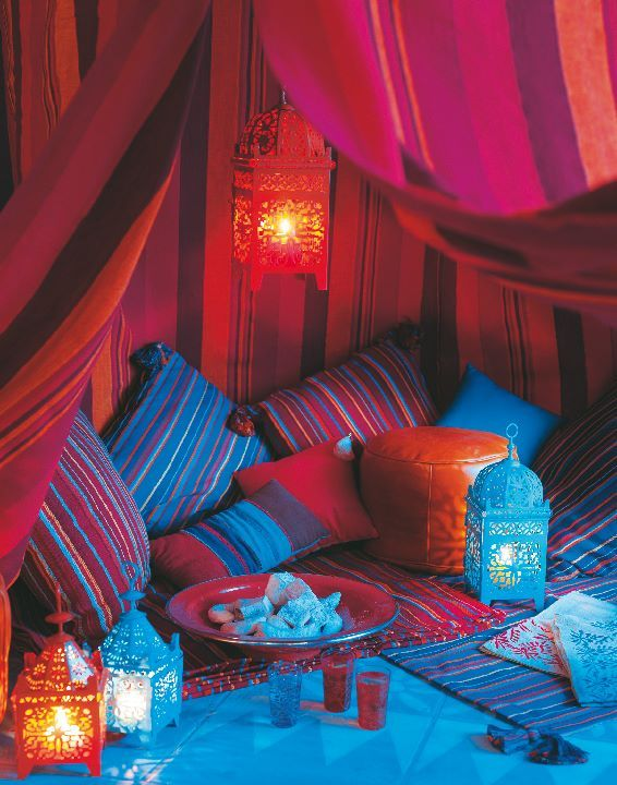 The inside of Jeannie's bottle is bigger than the outside. Moroccan lanterns and textiles enliven a cozy area.