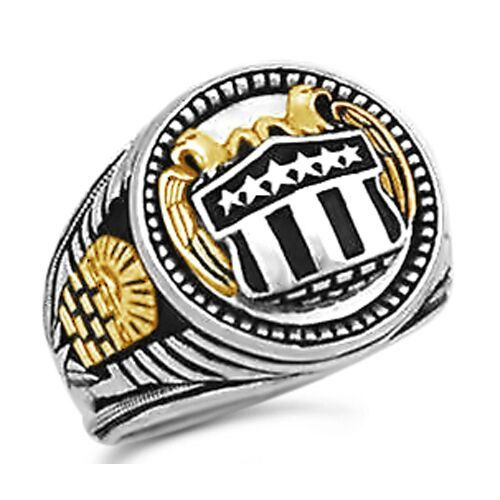 10 Karat Yellow Gold,Sterling Silver/.925    Handsome Coin ring(20.00/mm across top)....Stars and stripes silver Shield  flanked by 10 Karat yellow gold double eagles on mirrored background,in double bezel.......Fluted sides accented with 2-10 Karat yellow gold All seeing Eye on stepped unfinished pyramid.....All sculpted in 3-D fine detail......Solid back,not concave,ring sits flat on finger......Worked bottom shank make this a most unique ring.....Antique finish....State your finger…