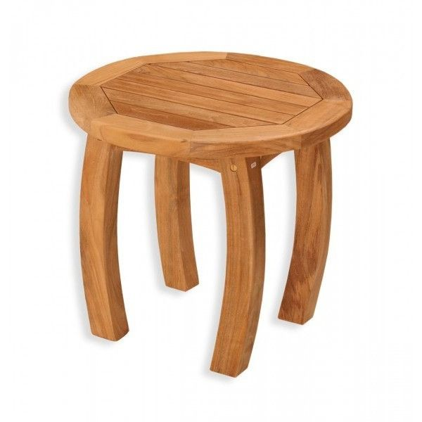 """Jakarta 20"""" Round  Side Table. Keep some munchies and a cold drink by your side with the Tortuga Outdoor Jakarta 20 in. Round Wood Side Table. This versatile teak side table's capable of adding so much to your outdoor space. Gently curving legs create a graceful appearance, while the traditional slatted top sheds moisture. This teak table is naturally resistant to rot, pests, and mildew and will gradually attain a silvery patina over time. Renowned for its durability and..."""