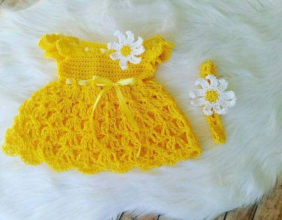 white crochet baby dress with sunflowers.