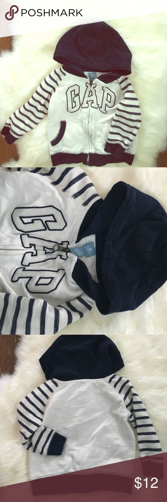 12-18 months Baby Gap zip up hoodie Baby Gap zip ups are the best!!! This one is in very lightly worn condition. Great quality. Colors are off white and navy blue. Size 12-18 months. Perfect for year round! Bundle and save!! ❄️ GAP Shirts & Tops Sweatshirts & Hoodies