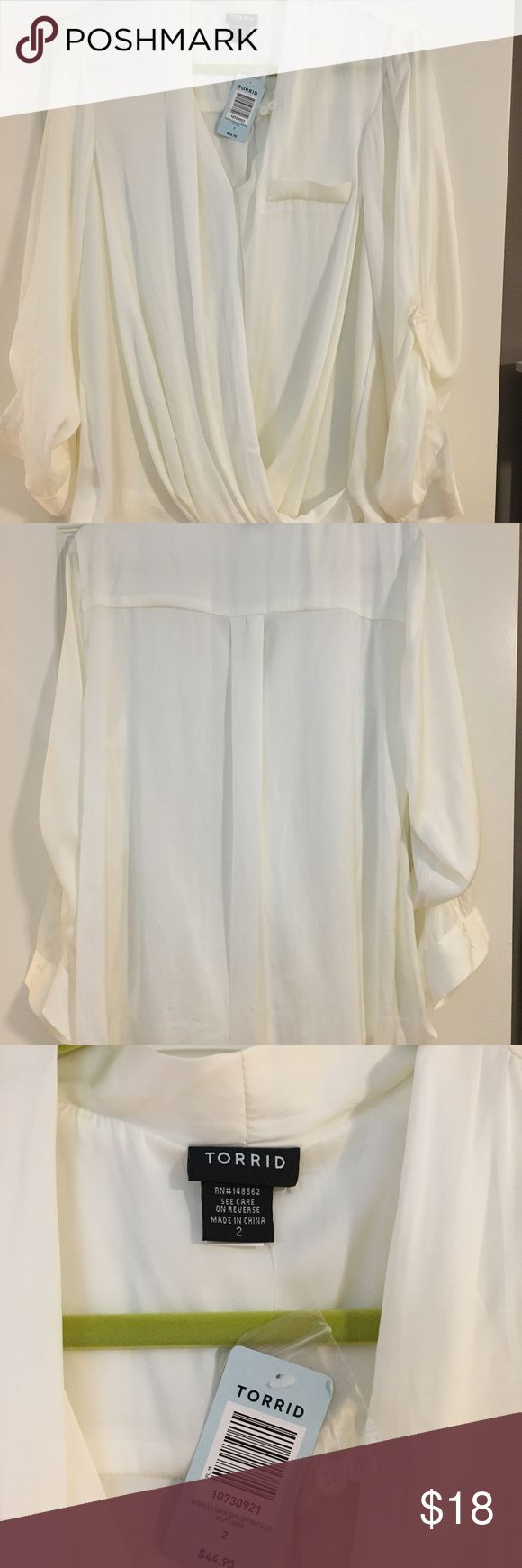Torrid dressy white blouse Sz 2 Torrid dressy white blouse Sz 2 long sleeve, but can also be rolled up and fastened w/ button draping in front of shirt high/low cut torrid Tops Blouses