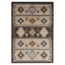 Egyptian-made rug with a Southwestern motif.  Product: RugConstruction Material: PolypropyleneColor: BarleyFeatures:  Machine-madeNo sheddingMade in Egypt  Note: Please be aware that actual colors may vary from those shown on your screen. Accent rugs may also not show the entire pattern that the corresponding area rugs have.Cleaning and Care: Vacuum regularly with non-beater attachment. Spot clean. Professional cleaning recommended.