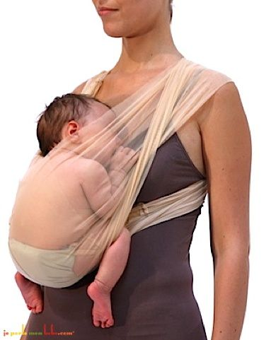 A picture of how baby should look inside a wrap style baby carrier. Make sure you can kiss the top of babys head.