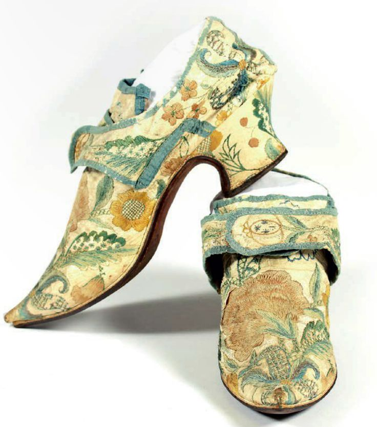 lady's embroidered leather shoes, 1720-1730, England. White kid embroidered in imitation of brocade with large carnations and other blooms. Lined in linen. | Kerry Taylor Auctions Catalog Dec 8, 2015 p.4