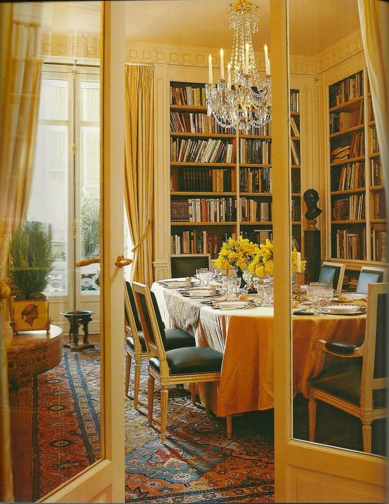 I may have pinned this before but I still love it: gorgeous dining room/library.  The golden-yellow paint is one of my fave colors for large spaces, and the warm-hued rug anchors it all.