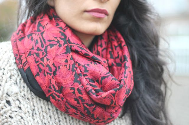 an embroidered scarf lending some colour to a casual winter outfit.