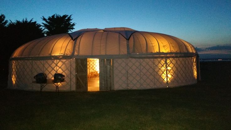 This yurt glowing in the sunset has a dance floor free