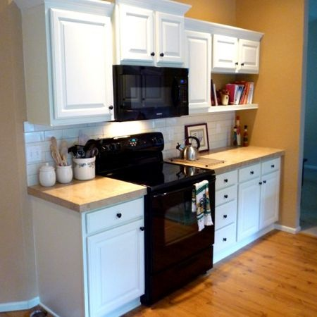Photos before and after kitchen remodels - White kitchen cabinets black appliances ...