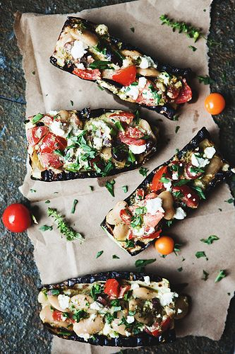 Grilled zucchini with beans, tomatoes, kalamata olives, goat cheese, and pesto.. via the little red house blog