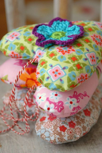 Stuffed hearts by dutch blue (crocheted flowers would look great on scrappy pin cushions)