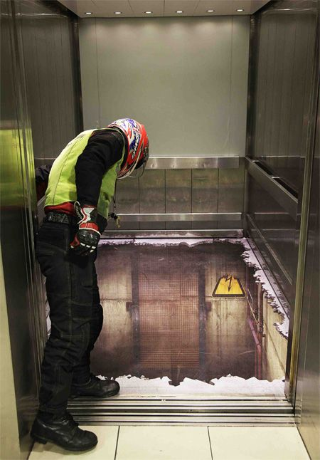 3D painting fools him into thinking the floor of the elevator has collapsed.