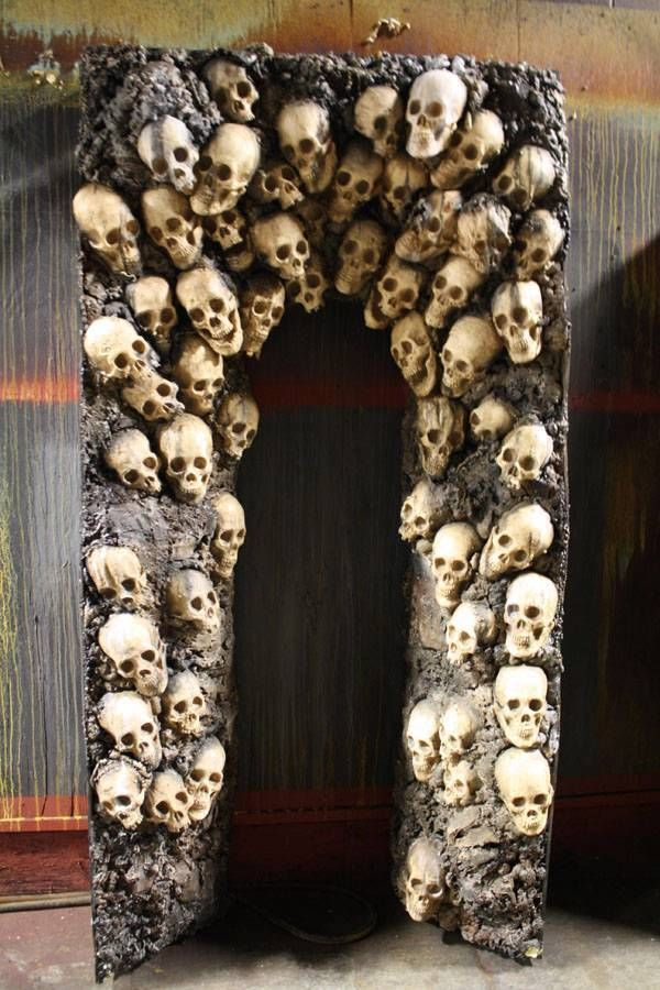 Make your own with dollar store skulls, glue gun, paper mache and spackling paste