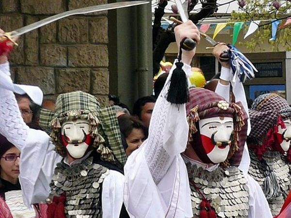 Greek Carnival Masks. Naoussa, Greece. Painted papier mache or wood. The busiest time for Naoussa, Greece, is the carnival period, when the custom of 'Boules' (men dressed in traditional costumes and masks) takes place and the whole city drinks and dances in the streets.