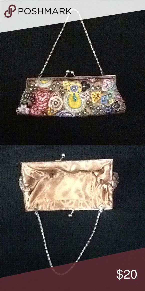 Evening Clutch Purse Gorgeous vintage sequin/beaded clutch purse with silver tone hardware Its a champagne colored satin material inside and has no stains. Accessories