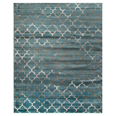 Anchor your living room seating group or define space in the den with this eye-catching art silk rug, featuring a Moroccan-inspired trellis motif.