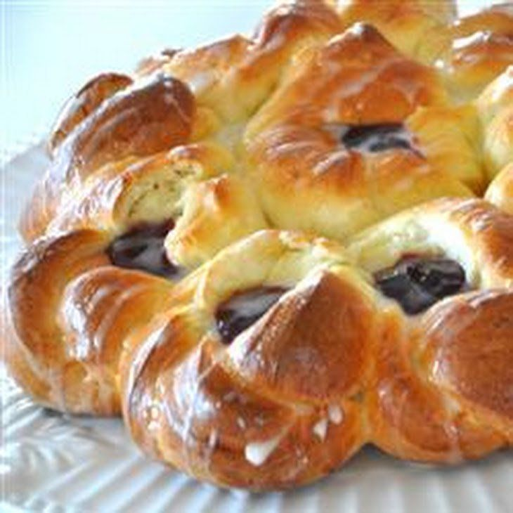 """""""A rich eggy dough is twisted into pretty flowers, then filled with jam in this decadent Easter bread. Be sure to look at the pictures for how it is formed. Lemon curd is an option"""