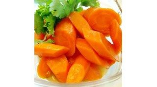 Baby carrots are gently boiled and then simmered with brown sugar and margarine.