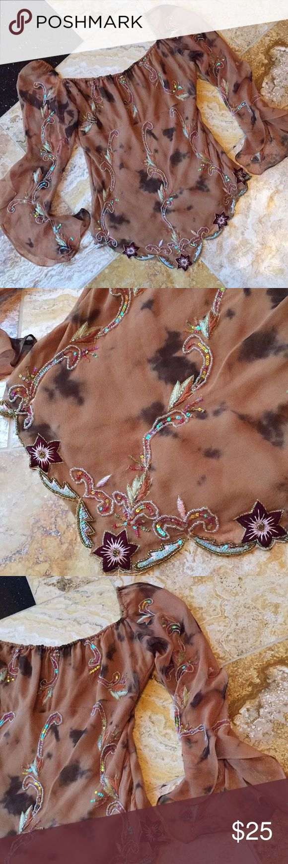 "Aftershock Caramel color silk ultrafeminine blouse The body is fully lined 100% silk in a Café au lait color with gorgeous sequins and embroidery. Scalloped hem ends in a point elongating the legs and torso, sheer sleeves open upon a soft ruffle. The ruched neckline allows for a right fit in the 17"" bust. Stunning and elegant for a night out with a skirt or just because with a pair of jeans! Aftershock Tops"