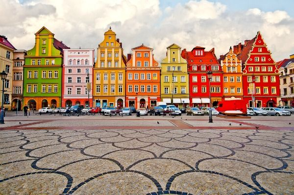 wroclaw poland no joke the facades are that colorful and wonderful places to love. Black Bedroom Furniture Sets. Home Design Ideas