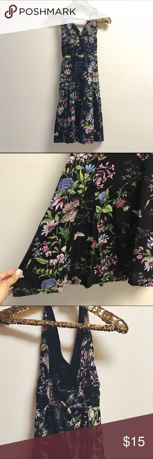 💐black floral halter sundress💐 black tie back halter dress with a delicate japanese inspired light pink & lavender floral print and a few beautifully placed butterflies.  elastic cinched back with a bow tie for an easy fit. bodice is a crepe polyester and the skirt is cotton, hits right around the knee (just above for me, 5'6). juniors size 1 but fits like a typical women's small. 0 flaws! from charlotte russe but the print is so beautiful it looks more expensive💜 Charlotte Russe Dresses