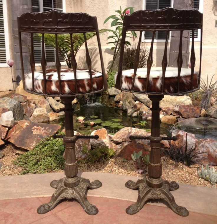 """Meet """"John Wayne"""" & """"Calamity Jane"""". An unbelievable pair these two make! Vintage legends made of true grit cast iron and paired with nothing less than magnificent rustic cowhide. This couple will go down in the history books of your home as the most admired and talked about pair. As they should! This pair of beauties offered at $1795.00."""