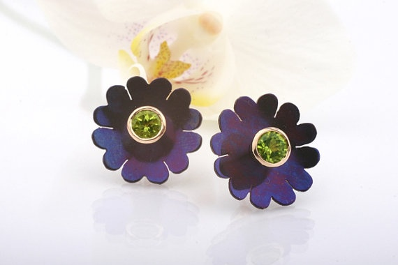 Flower Ear Studs. Titanium and Yellow Gold Earrings with Peridots by CaiSanni via Etsy.