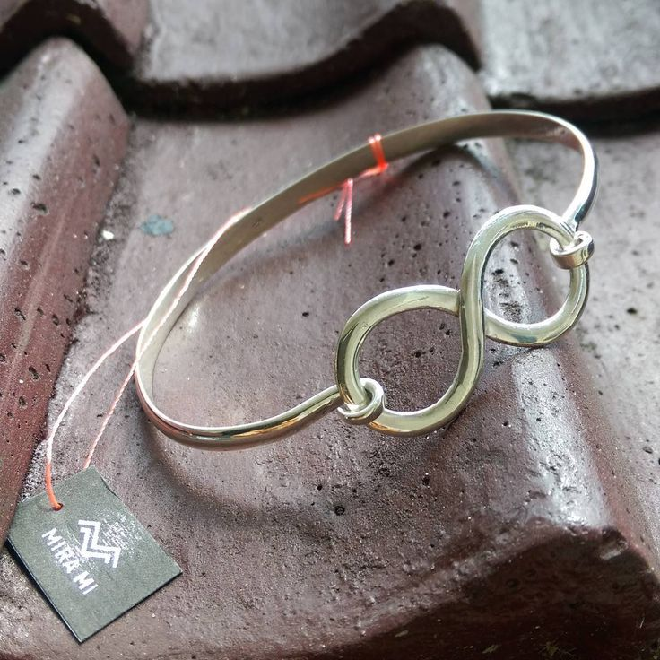 """A beautiful handmade silver infinity bracelet.  Origins of the Word """"Infinity""""  As repeatedly mentioned anchors are all about being strong and stable. No matter if you have sea legs or not, you can appreciate the deeper meaning of the anchor symbol - security, stability, and being grounded. It is a symbol demonstrating that a person is in tune with themselves and hold on to the values they believe in. The anchor can also represent a person who has been someone's rock through difficult times…"""