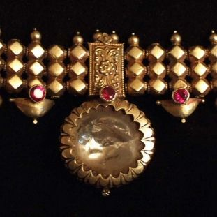 This necklace found in  Madhya Pradesh ( most come from South India, Karnataka and Tamil Nadu) is part of a woman's stridhana and stays legaly her property for life.