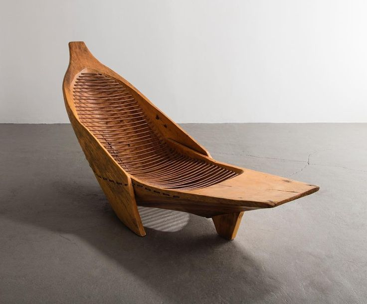 "#HugoFranca is a true designer-craftsman. He can manipulate, and tame, felled trees and retired canoes into functional and sculptural work. This ""Sirinhaem"" chaise lounge in juerana wood and leather is available now. To learn more, contact us at r@r-and-company.com. #ContemporaryDesign #RandCompany @atelierhugofranca"